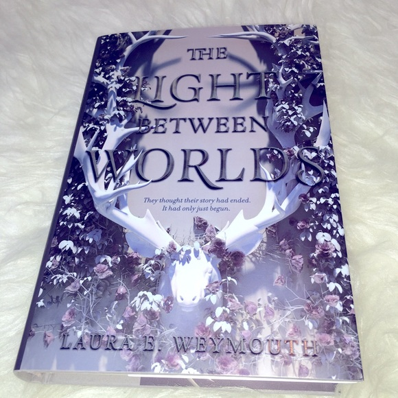 The Light Between Worlds by Laura Weymouth book